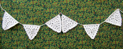 Christmas bunting crocheted in white cotton