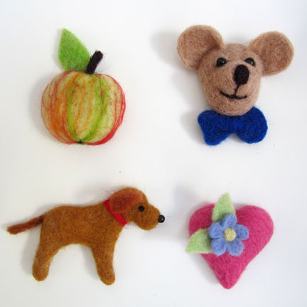 selection of Needlefelt brooches