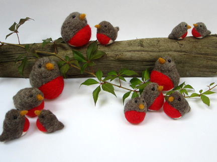 needlefelt robins on a log