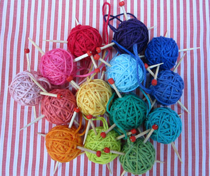 mini balls of yarn with needles