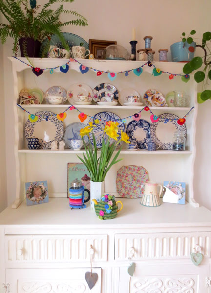 dresser with crochet hearts and flower garland