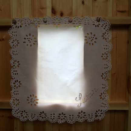window with cutwork cloth